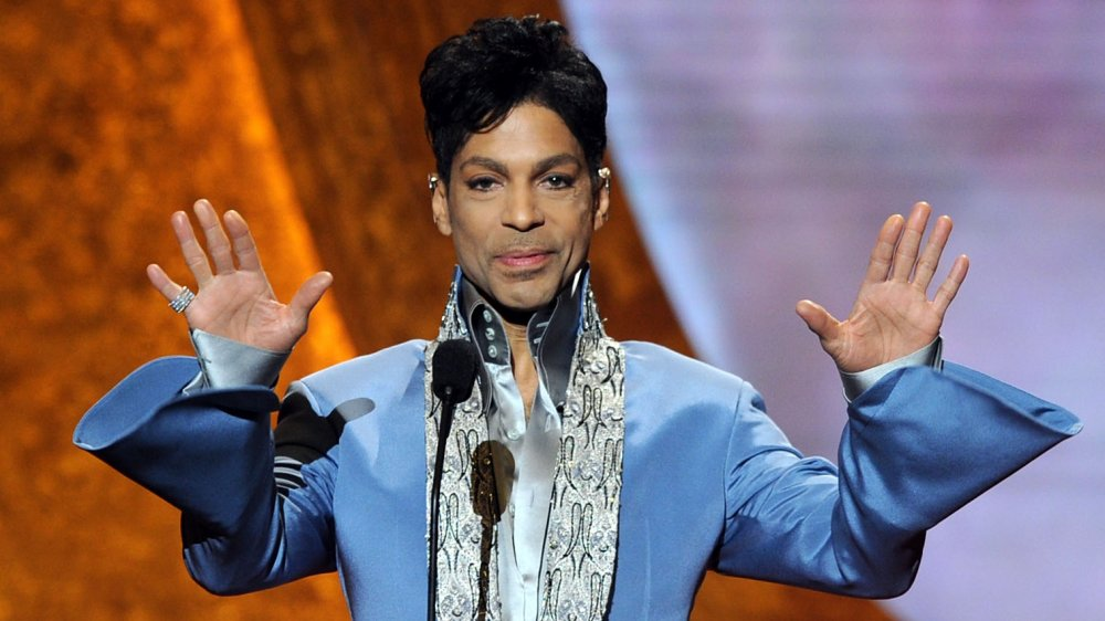 Prince hands in the air on stage