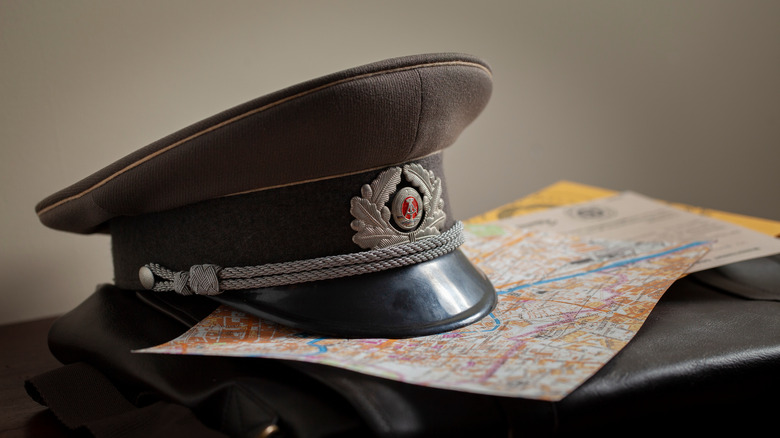 Soviet military hat on map