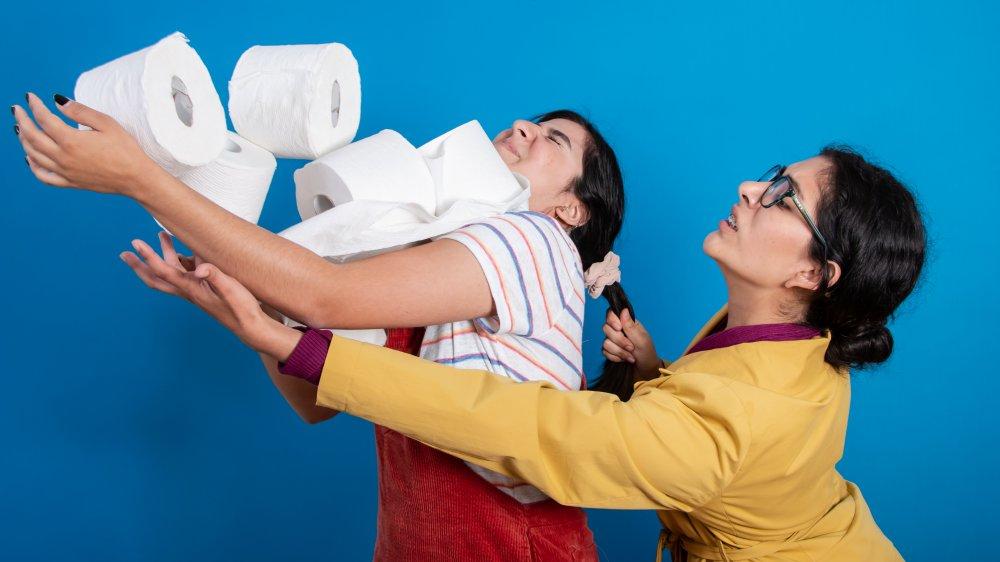 women fighting over toilet paper