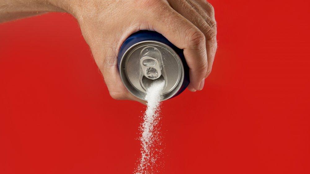 dumping sugar soda