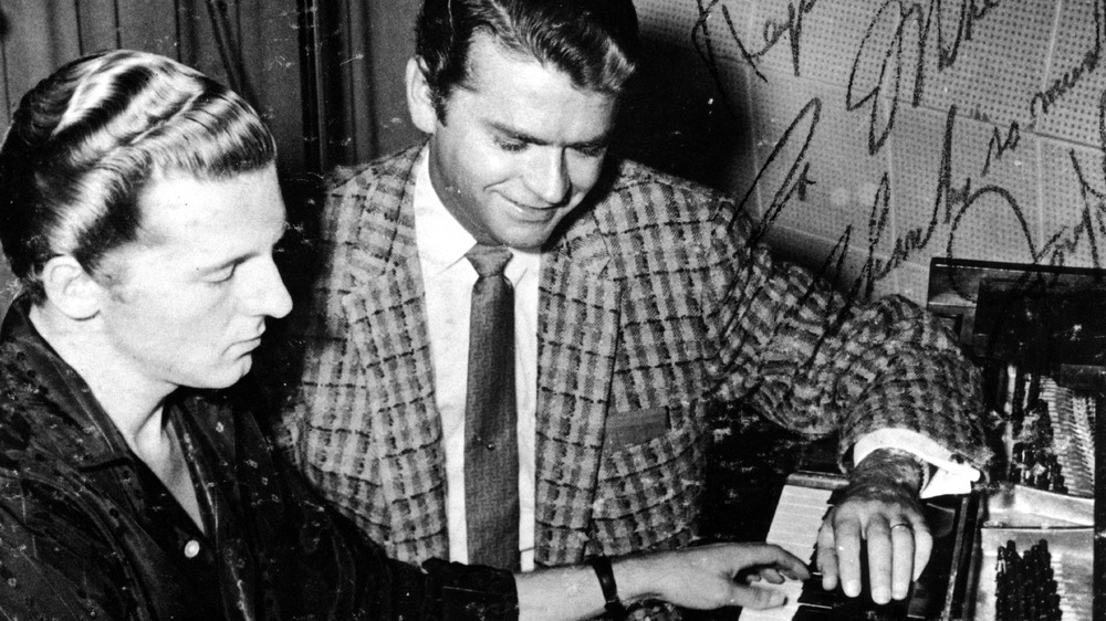 Sam Phillips overseeing a recording