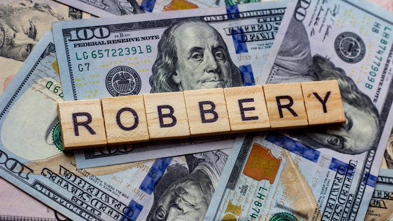 "money and blocks spelling ""robbery"""