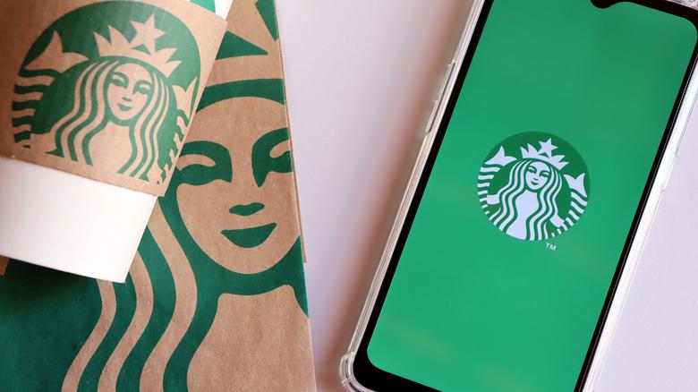 Starbucks cup, bag, and logo on phone