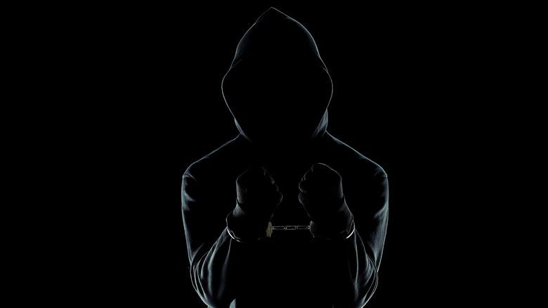 handcuffed male in hoodie