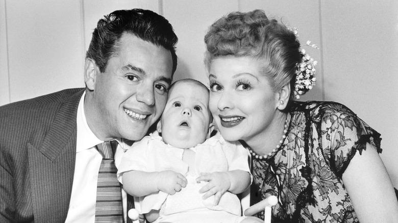 Desi Arnaz and Lucille Ball posing with son Desi Jr.