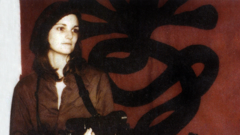 Patty Hearst robbing a bank with the SLA