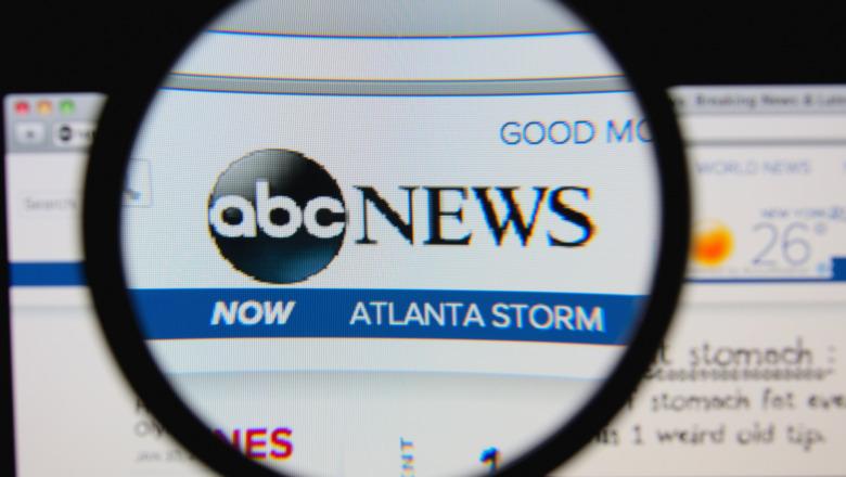 ABC News logo beneath a magnifying glass on someone's desktop