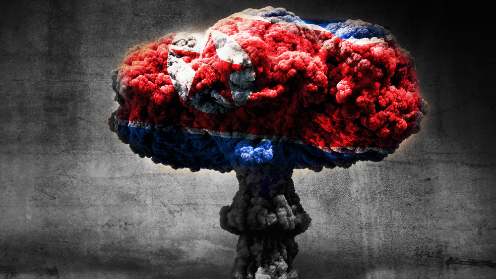 Nuclear mushroom cloud with North Korean flag superimposed
