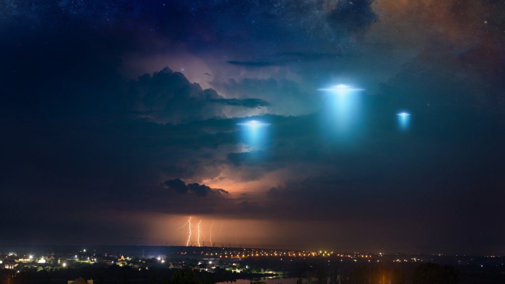 An artist's rendition of UFOs over a town