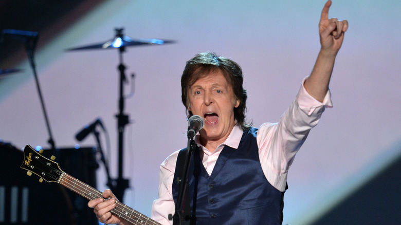 Paul McCartney performing on stage
