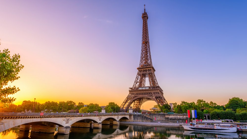 View of Eiffel Tower and river Seine at sunrise in Paris, France.