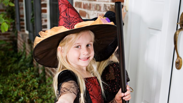 girl trick-or-treating witch