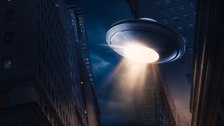 Flying saucer over a city