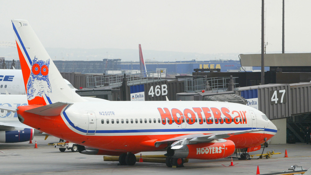 A Hooters plane arrives at Gate 47
