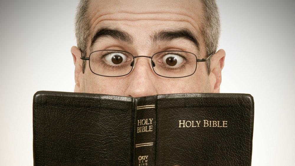 reading bible surprised