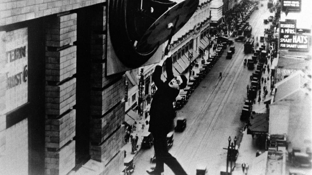 Harold Lloyd hanging from a clock in Safety Last!