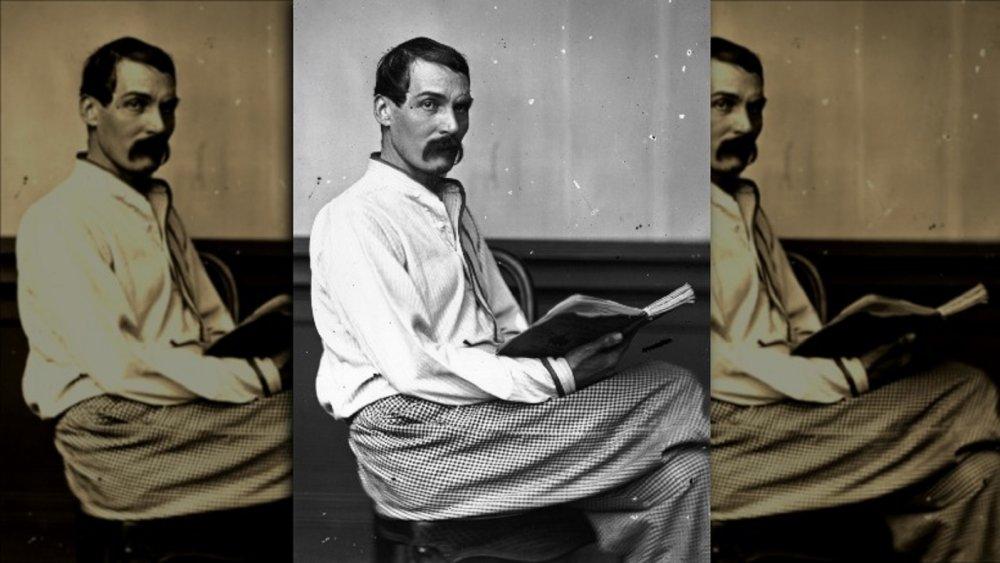 1864 image of Sir Richard Burton reading