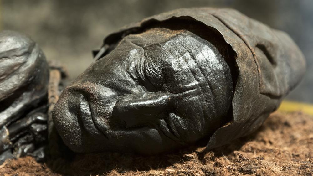 bog body bronze statue