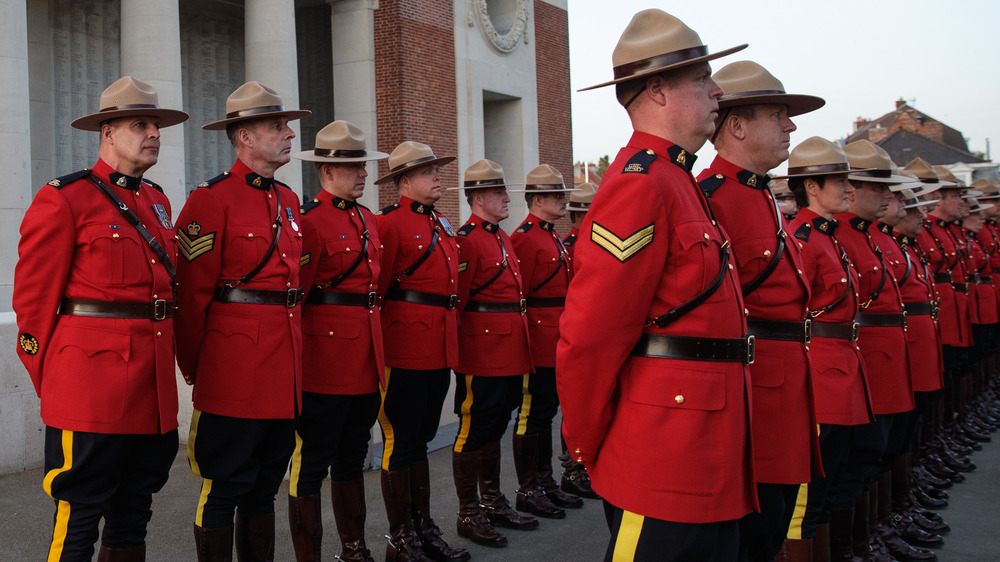 Royal Canadian Mounted Police parade following the Last Post ceremony in front of the Menin Gate Memorial to the Missing on April 6, 2017 in Ypres, Belgium.