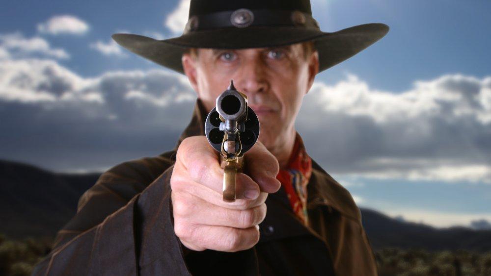Cowboy pointing gun