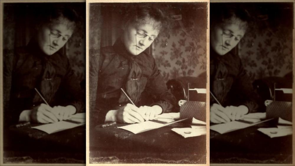 Edwardian woman writing at a desk