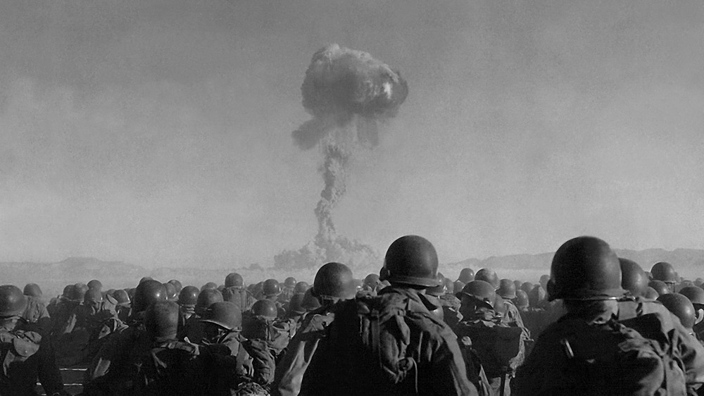 Atom bomb test and soldiers