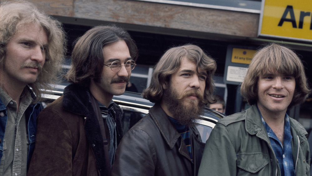 the members of Creedence Clearwater Revival on a bench