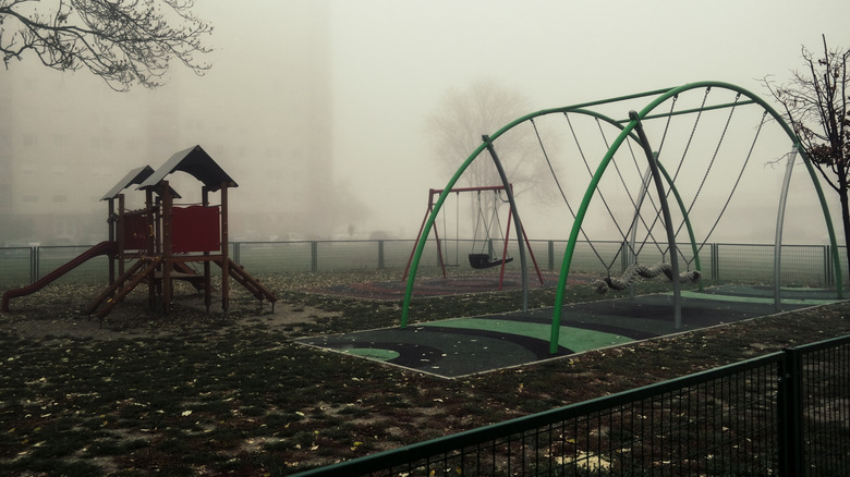 Empty playground covered in fog