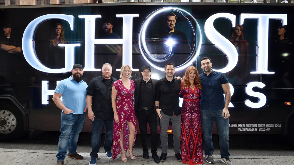 The Ghost Hunters crew in front of tour bus