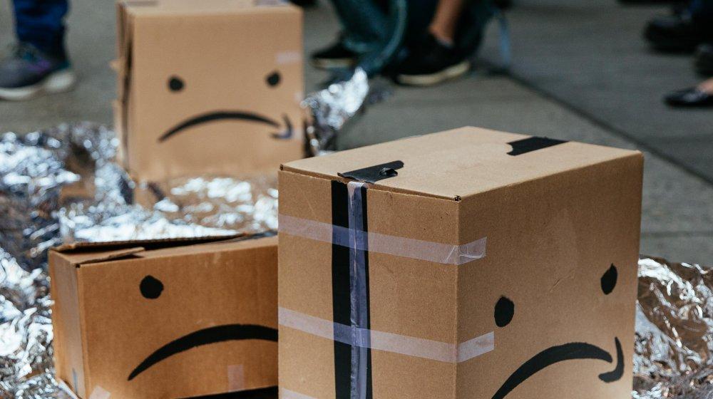 Sad faces drawn on Amazon parcels by protestors