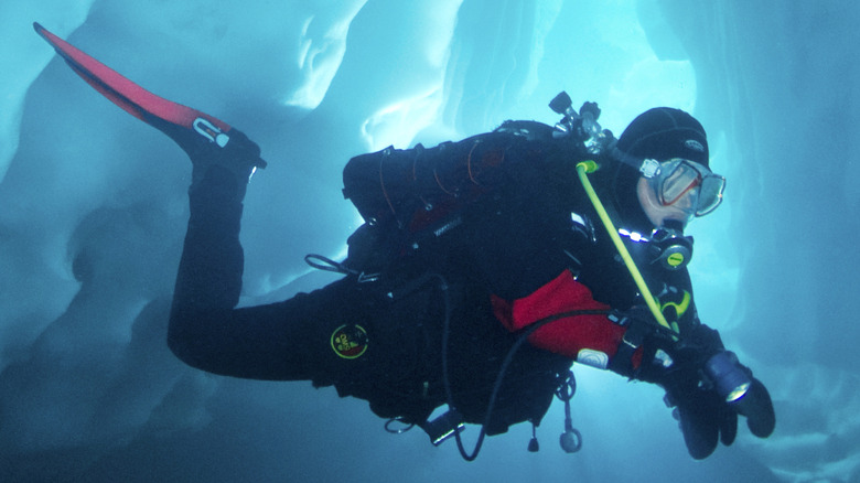 Scuba diver surrounded by ice