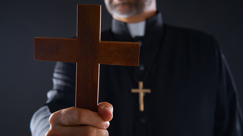 Priest with cross