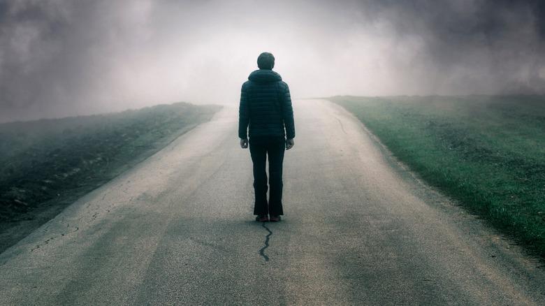 man on dark road