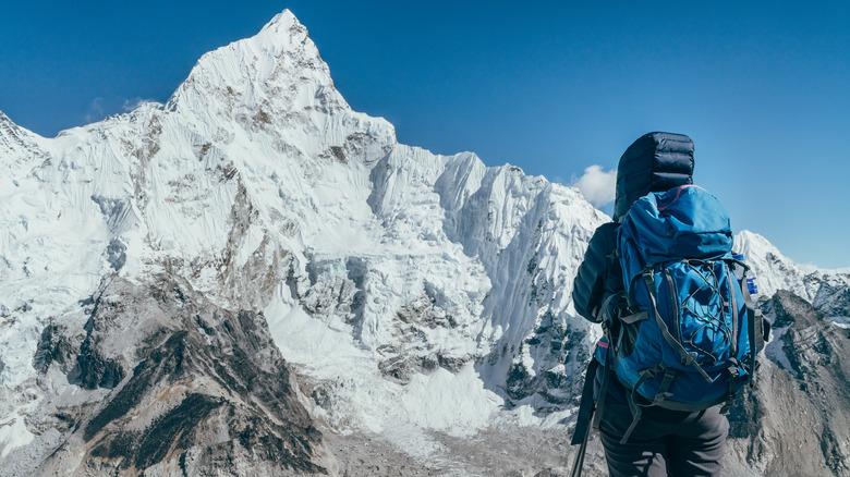 mountain climber on snow-capped mountain