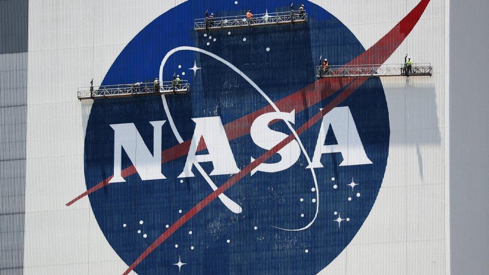 A giant NASA logo undergoing repairs.