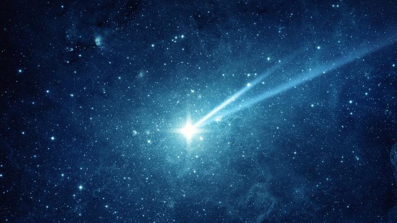 Falling meteorite, asteroid, comet in the starry sky.