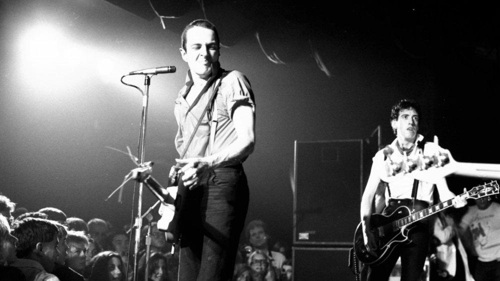 Joe Strummer and Mick Jones playing live