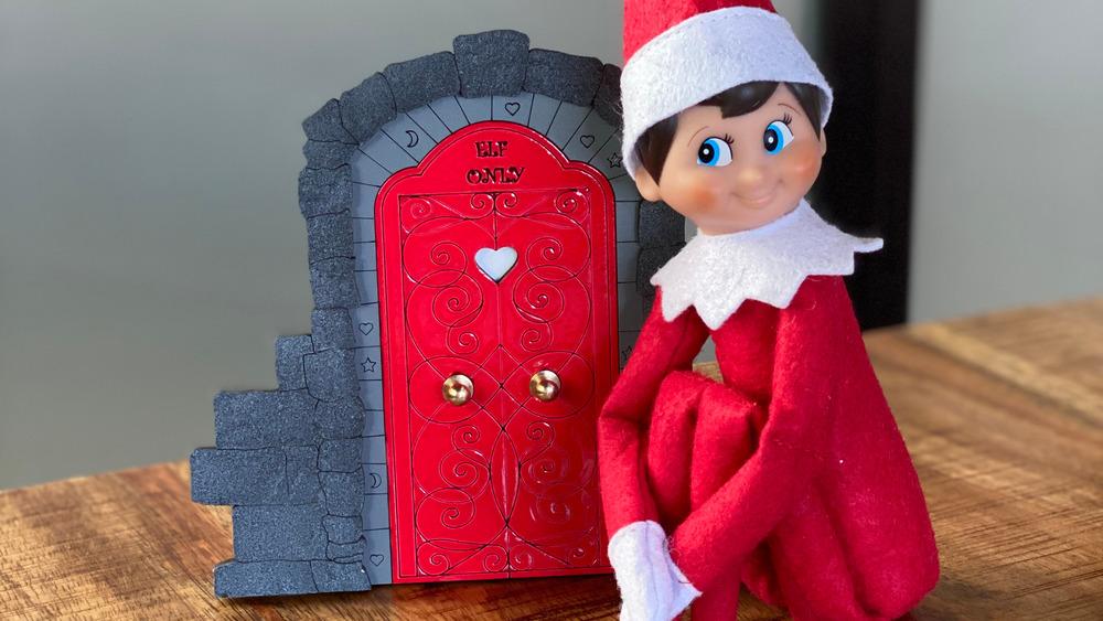 A Christmas elf sits on a shelf