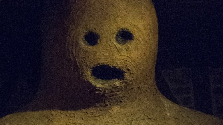 Golem close up, Prague, Czech Republic. In Jewish folklore, a golem is an animated anthropomorphic being that is magically created entirely from clay or mud. Has scary red eyes