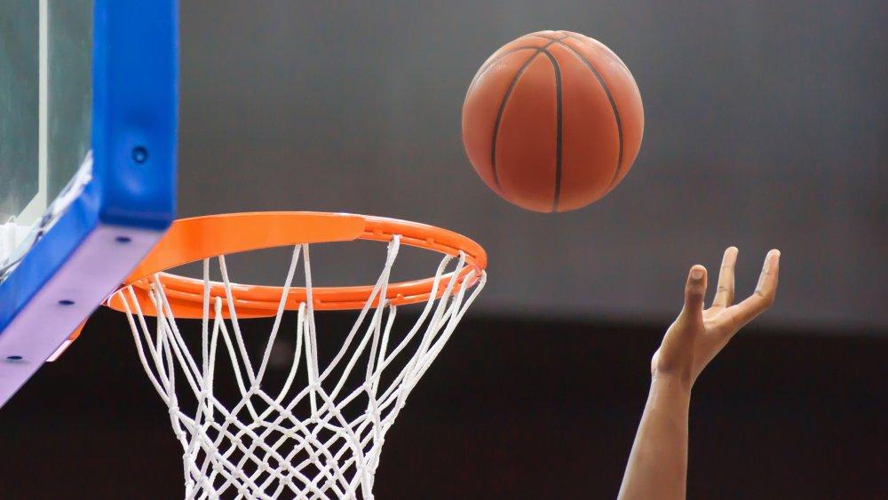 Basketball flying into the hoop