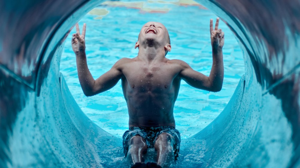 Boy about to tumble into a world of pain - at a pool
