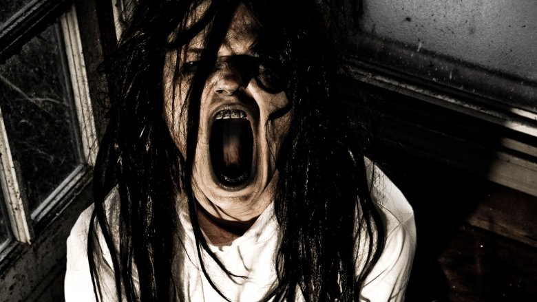 possessed person with mouth open