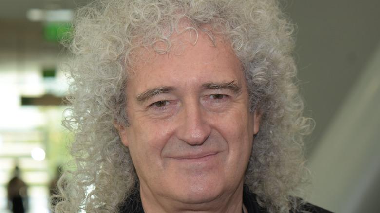 Brian May smiling