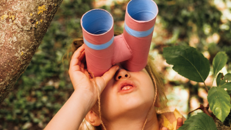 Little girl using binoculars