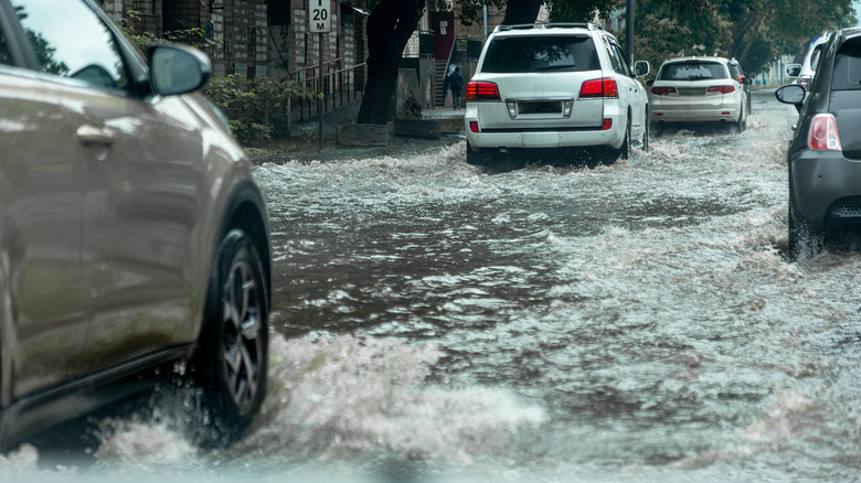 Cars driving through floodwaters