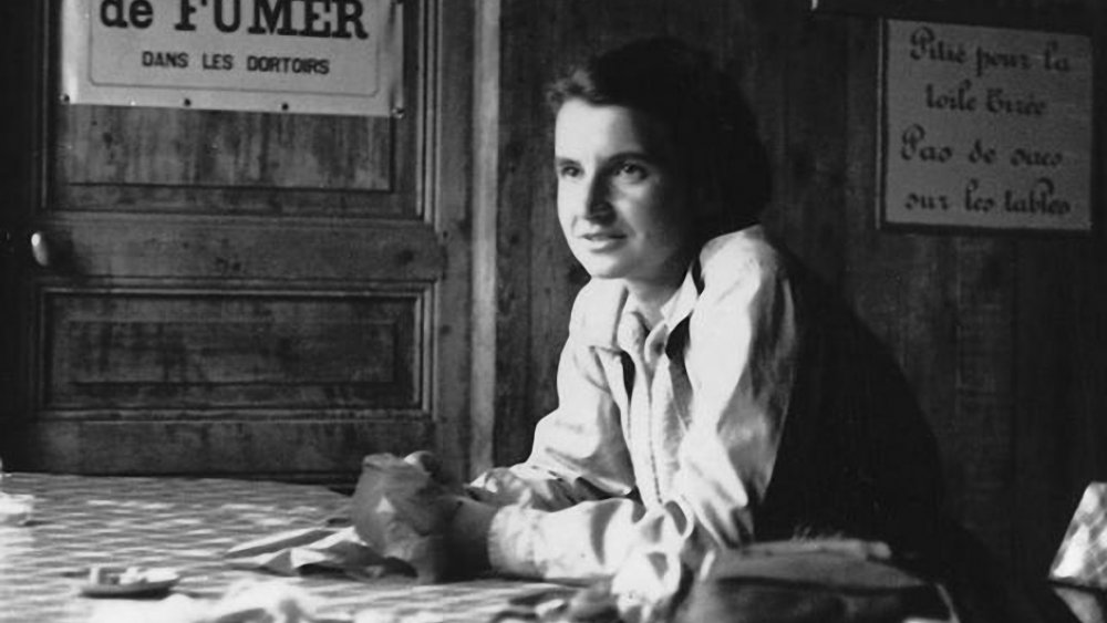 Rosalind Franklin at table in French laboratory