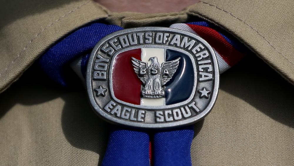 Boy Scout wearing Eagle Scout kerchief slide