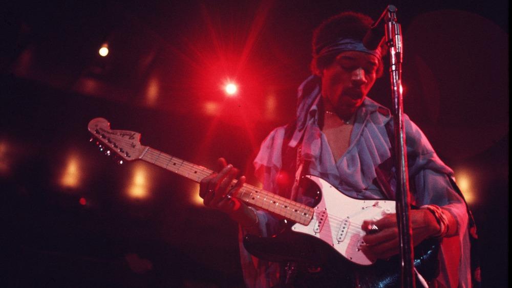 Jimi Hendrix plays
