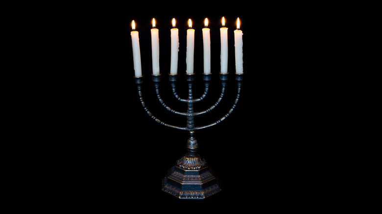 Lit menorah with seven candles