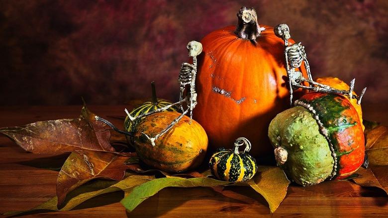 Small skeleton figures on pumpkins